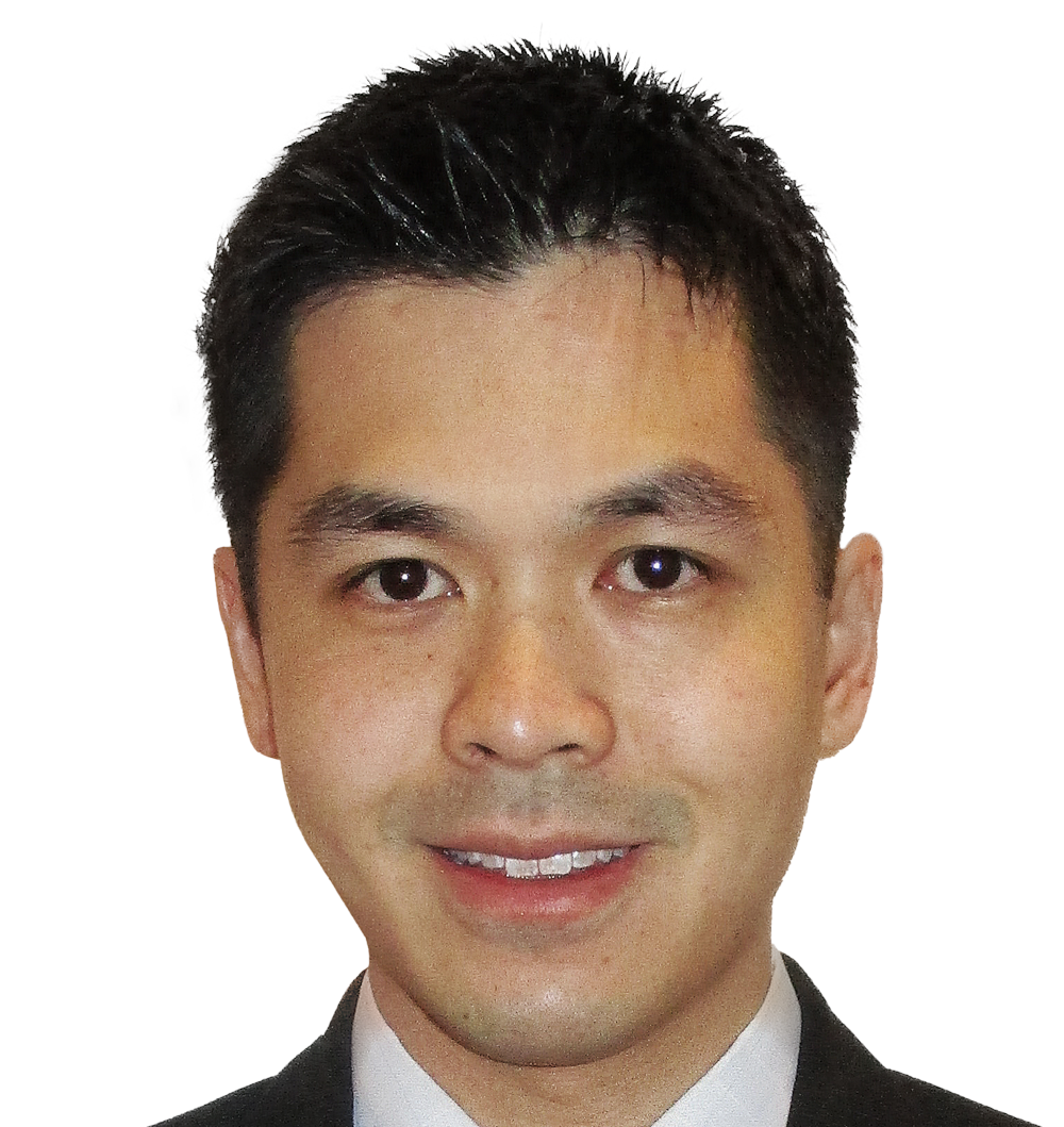 A man smiles at the camera. He is Asian, with black hair and dark brown eyes. He is wearing a white shirt and a black blazer. He is a Monash IVF doctor.