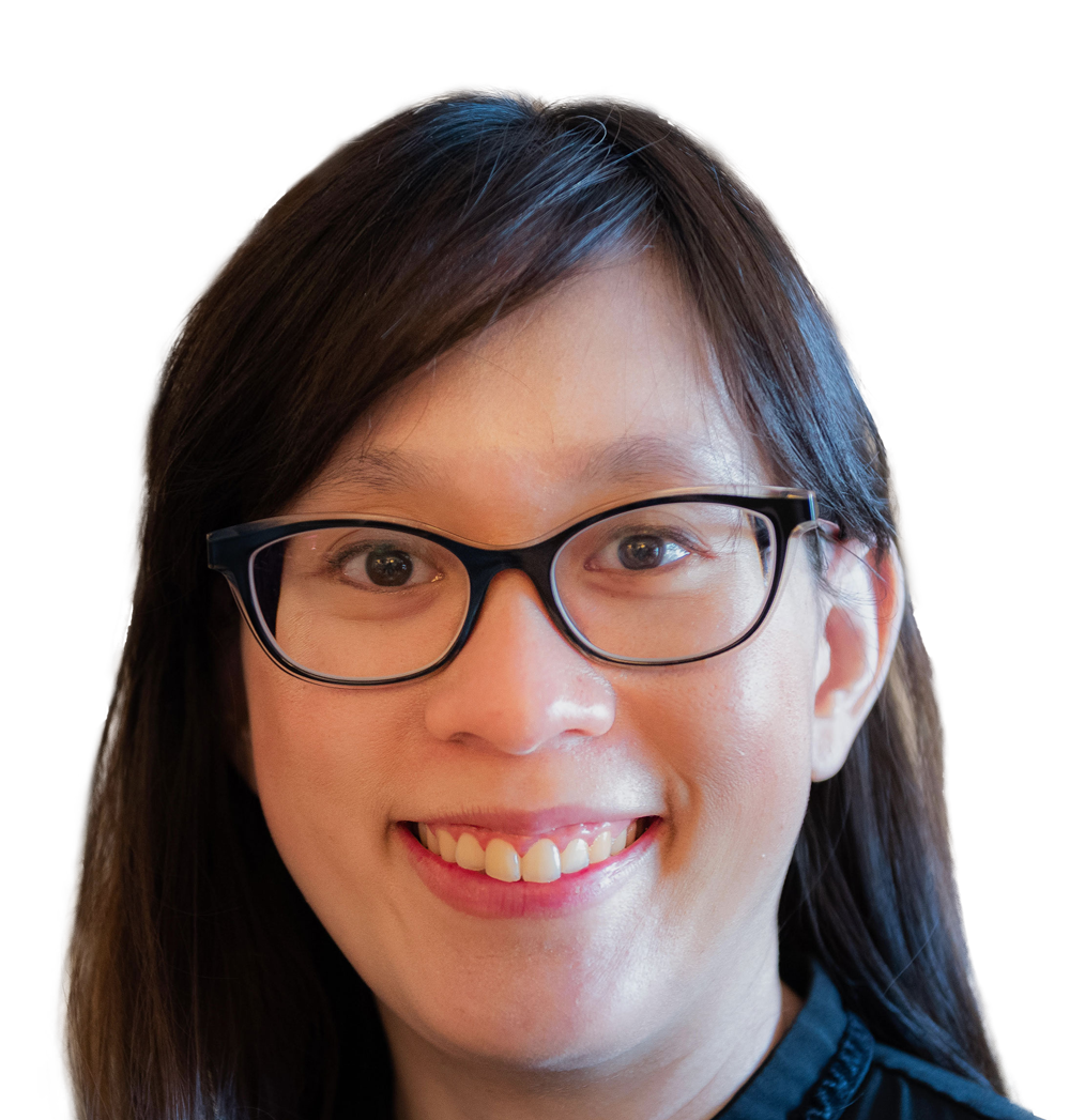 A woman smiles. She is Asian with long brown hair, oval shaped glasses with black rims, and dark brown eyes. She is a Fertility Specialist in New South Wales.