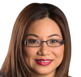 A woman smiles at the camera. She is Asian, with long brown hair and brown eyes. She is wearing a striking pink-red lipstick, and has on rectangular shaped glasses with a black and silver frame.